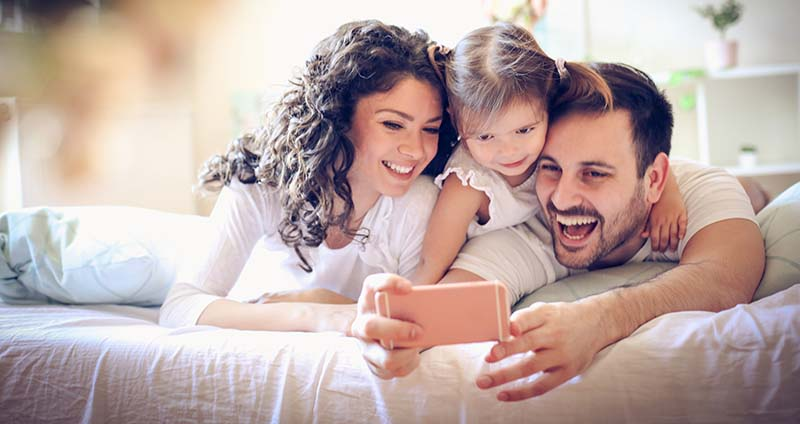 Happy Family Take a Selfie with Smart Phone in the Safety of Their Home