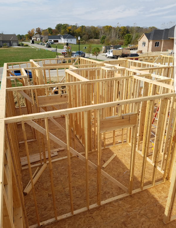 Home Framing in Process in a Beautiful Neighborhood