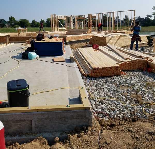 Construction Crew Framing a House