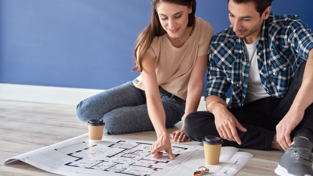 Couple Checking the Design of their Future House